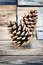 Stock Image : Pine cones on old  wooden background