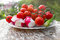Stock Image : Plate with cherry tomatoes, cucumber, pepper