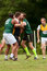 Stock Image : Player Gets Tackled In Amateur Game Of Australian Rules Football