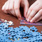 Stock Image : Playing with jigsaw puzzles