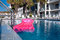Stock Image : Pool and pink air mattress