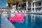 Stock Image : Pool and pink air mattress