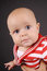 Stock Image : Portrait of baby on a dark background