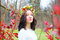 Stock Image : Portrait beautiful girl with flower wreath in the colorful autumn park