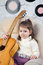 Stock Image : Portrait of the little girl with a guitar in hands