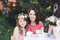 Stock Image : Portrait of mother and daughter at tea table