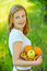 Stock Image : Portrait of woman holding basket with fruits