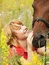 Stock Image : Portrait of young nice girl  with her horse