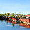 Stock Image : Porvoo in Finland. Old wooden red houses on the riverside