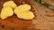 Stock Image : Potatoes on the cutting board