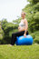Stock Image : Pregnant woman belly swiss fit ball workout park