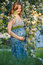 Stock Image : Pregnant woman with blossom branch
