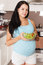 Stock Image : Pregnant woman eating a salad smiling