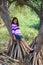 Stock Image : Pretty girl on tree