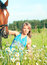 Stock Image : Pretty women with her horse in blossom meadow