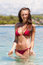 Stock Image : Pretty young woman in red bikini in water