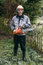 Stock Image : Professional gardener with chainsaw