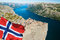 Stock Image : Pulpit Rock in Norway with flag