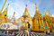 Stock Image : RANGOON, MYANMAR - October 11, 2013: Buddhist people visit Shwedagon Pagoda in Rangoon