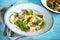 Stock Image : Ravioli pasta filled with ricotta, egg yolk and black truffles