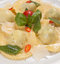 Stock Image : Ravioli with red chily pepper and sweet basil