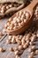 Stock Image : Raw chickpeas in a wooden spoon close-up vertical