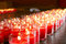 Stock Image : Red burning candle in a temple