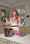 Stock Image : Red haired woman with new multicooker and small dog