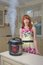 Stock Image : Red haired woman with new multicooker