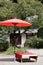 Stock Image : Red umbrella in garden