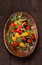 Stock Image : Red and yellow tomatoes on wooden plate