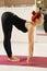 Stock Image : Redhead in bending forward yoga pose