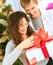 Couple Opening Christmas Gift