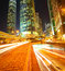 Stock Image : Road tunnels light trails on modern city buildings backgrounds i