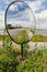 Stock Image : Round mirror on a pole by the road