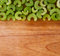 Stock Image : Row of chopped celery pieces against wood