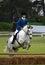 Stock Image :  Ruiter die met paard springen
