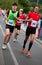 Stock Image : Runners on Palackého bridge of PIM