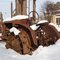 Stock Image : Rusty tractor in the snow