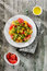 Stock Image : Salad with arugula, yellow tomatoes and red grapefruit