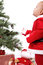 Stock Image : Santa Baby boy standing next to Christmas tree.