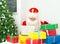 Stock Image : Santa Claus checking wish list.
