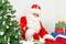 Stock Image : Santa Claus ironing clothes.