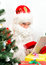 Stock Image : Santa Claus is using tablet pc.