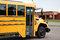 Stock Image : School bus in front of an elementary school
