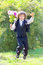 Stock Image : Schoolboy in uniform with a bouquet jumps