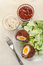 Stock Image : Scotch eggs cut in halves on a plate