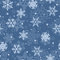 Seamless pattern of snowflakes, light blue on blue