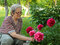 Stock Image : Senior Woman and Flowers