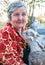 Stock Image : Senior woman holding a goatling